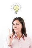Thinking young woman with idea bulb. Royalty Free Stock Images