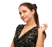 Thinking young woman pointing up Stock Photo