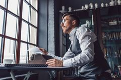 Thinking young writer at work. In the office royalty free stock image