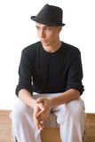 Thinking youth in a hat royalty free stock images