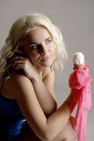 She thinks about him. There is blond girl with ice cream. She is thinking about somebody Stock Images