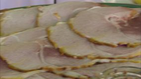 A thinly sliced ham. A pan to right close up shot of a thinly sliced ham stock footage