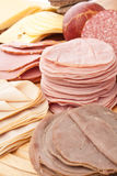 Thinly Sliced Meats on White Background Stock Images