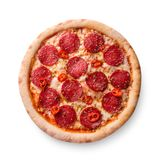 Thinly sliced pepperoni is a popular pizza topping in American-style pizzerias. Isolated on white background. Still life royalty free stock photos