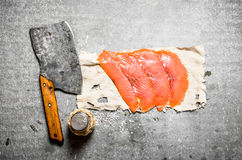 Thinly sliced smoked salmon with a hatchet and salt. Stock Photography