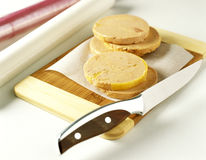 Thinly slicing the foie gras Stock Photo