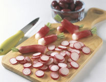 Thinly slicing the radishes Stock Photos