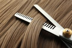 Thinning scissors on light brown hair, closeup. Hairdresser service royalty free stock photography
