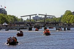 Thiny bridge in Amsterdam. Netherlands at queensday Royalty Free Stock Photo