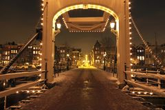 Thiny bridge by night in Amsterdam Netherlands. Thiny bridge by night in Amsterdam the Netherlands in winter Royalty Free Stock Photos
