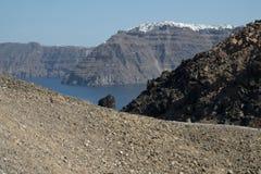 Thira from Nea Kameni. Santorini`s capital Thira seen from the rocky volcanic island Nea Kameni in the caldera Royalty Free Stock Image