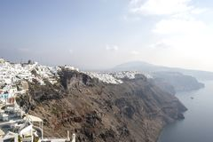 Thira, Santorini - panoramic view. Panoramic view Traditional famous white houses and churches in Thira town on Santorini island stock photos