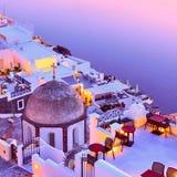 Thira town and Aegean sea at sundown stock photo