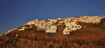 Thira town on rocky island Stock Photos