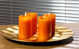 Third advent. Three advent candles on a golden plate Stock Image