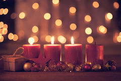Third advent. Christmas decoration with christmas bauble and candle for advent season three candles burning Royalty Free Stock Image