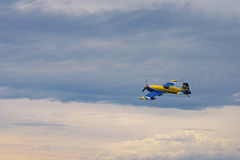 Third AirFestival at Chaika airfield. Small plane flies in storm clouds royalty free stock photo