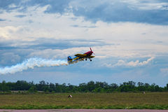 Third AirFestival at Chaika airfield. A small sports plane takes off in an unusual way. stock photos
