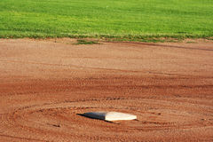 Third base. Baseball field third base freshly raked royalty free stock images