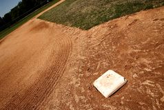 Third base bag on baseball field Stock Photos