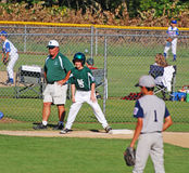 Third base coach. with boy on base. Stock Images