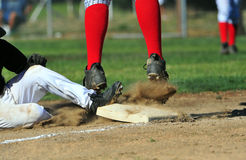 Third base coming out. stock images