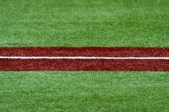 Third base with a white caulk line. Baseball Stock Photos
