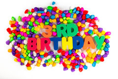 Third birthday word in colorful stone Royalty Free Stock Image