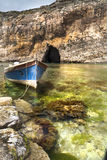 Third boat. Beautiful small bay with amazing sea cave in Malta Royalty Free Stock Photos