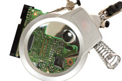 Third hand magnifier with electronic circuit Royalty Free Stock Photo