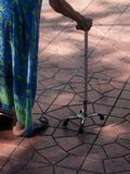 The third leg for old age. An old woman walking with a cane royalty free stock photo