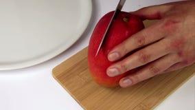 Third Of A Mango Cut Off In A First Cut stock video