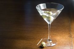 The Third Martini. A martini with olives and empty toothpick - the 3rd martini Stock Photos