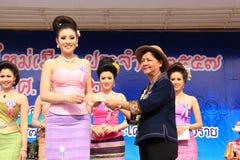 The Third Runner-Up for Miss Songkran 2014. Chiangrai, Thailand - April 13, 2014: The third runner-up is receiving award for Miss Songkran Beauty Contest 2014 Stock Photos