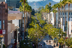 Third street promenade in Santa Monica California. Stores, restaurants, palm trees and people at the 3rd street promenade in Santa Monica Royalty Free Stock Image