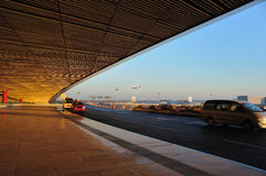 Third terminal of Beijing Airport. Is a great building from many views. This is a corner of roof with a plane is landing Royalty Free Stock Photo