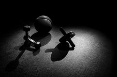Thirds Dumbbel Kettle Bell Ab Wheel. A motivational dark contrast image to help focus people on wanting to workout royalty free stock photos