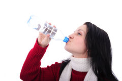 Thirst. Portrait of the young girl drinking from a bottle on a white background Royalty Free Stock Images