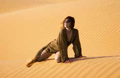 Thirst. Woman lost in the desert Royalty Free Stock Image