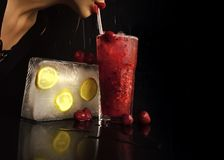 Thirst and refresh. Woman drink cocktail with ice cube. Party and summer vacation. Bar and restaurant, lemonade. Cocktail with strawberry for young girl stock images