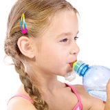 Thirsty. Young girl with bottle Stock Images