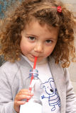 Thirsty. Little girl drinking mineral water Royalty Free Stock Photography
