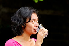Thirsty asian girl drinking pure mineral water Stock Photo