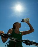 Thirsty bicyclist Royalty Free Stock Photo