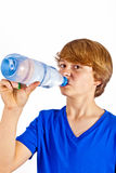 Thirsty boy is drinking water. Out of a bottle Stock Image