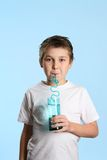 Thirsty boy drinking water Royalty Free Stock Photography