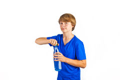 Thirsty boy is drinking water Stock Images