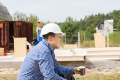 Thirsty builder taking a coffee break Stock Image