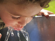 Thirsty, Child drinking  from fountain Royalty Free Stock Photos