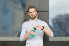Thirsty concept. Young guy look thirsty. Thirsty man hold water bottle. A drop of water is life for a thirsty person Royalty Free Stock Image